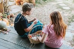 children a boy and a girl in pajamas sharing candy Product Image 1