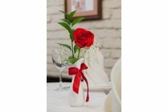 Rose flowers in a vase on a celebratory table Product Image 1