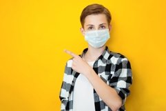 Teen boy in sterile face mask posing Product Image 1