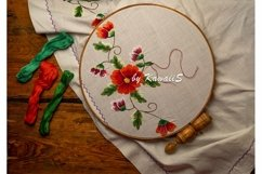 Flower embroidery on white textile in hoop wooden background Product Image 1