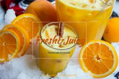 Orange homemade lemonade. Decanter of orange juice with mint Product Image 1