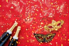 Two champagne bottles, carnival mask and golden confetti Product Image 1