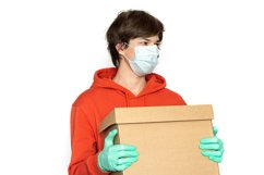 Contactless delivery. A man in a medical mask and gloves Product Image 1