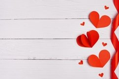 Paper hearts over white wooden background. Sainte Valentine Product Image 1