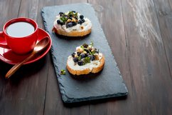 cup of strong coffee and sandwiches with soft cheese Product Image 1