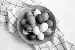 chicken eggs white and brown color in a gray plate and towel Product Image 1