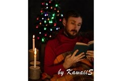 Man reads book at home burning candle glowing Christmas tree Product Image 1