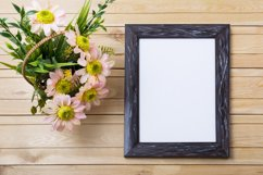 Rustic black frame mockup with pink daisies and green grass Product Image 2