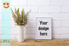 White frame mockup with grass and green leaves in vase Product Image 1