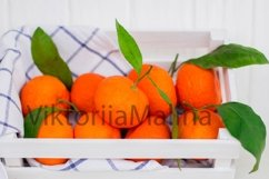 Bright tangerines in a white small box on a white background Product Image 2