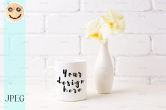 White coffee mug mockup with soft yellow orchid in vase Product Image 1