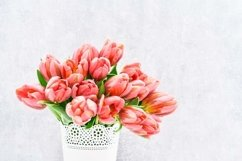Pink tulips bouquet in white vase on light background. Product Image 1