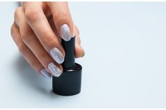 Winter manicure and a bottle of nail polish with copy space Product Image 1