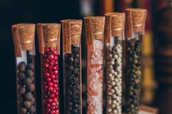 Colorful various spices in wooden spoons on old dark Product Image 1