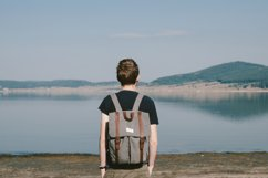 Hipster boy admires beautiful view Product Image 1