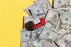 Car toy,shopping cart and dollar bills Product Image 1