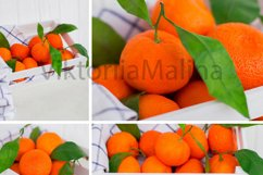 Bright tangerines in a white small box on a white background Product Image 1