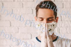 Religious man in protective gloves and face mask pray God Product Image 1
