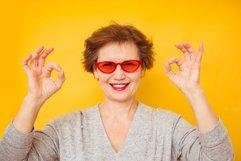 Older female feeling positive and enjoy concept Product Image 1
