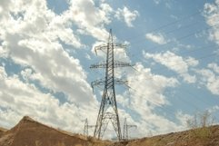 High voltage tower against the blue sky with clouds Product Image 1