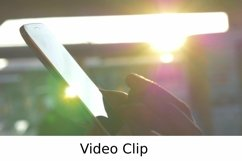 Video: Female hands typing on cell against evening sunshine Product Image 1