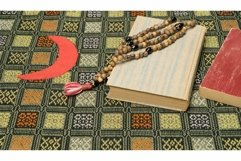 Muslim prayer beads and Quran on the prayer Mat. Ramadan Product Image 1