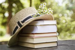 Books in rustic style with hat and flowers. Product Image 1