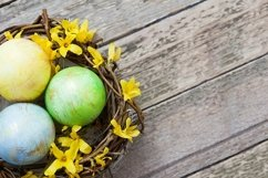 Nest with eggs and flowers on Wooden background Product Image 1