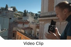 Video: Woman with retro camera on the balcony Product Image 1