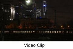 Video: Passenger train passing through the city at night Product Image 1