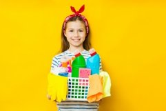 Smiling child girl holding basket with detergents Product Image 1