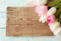 Aerial pink tulips on rustic wooden background Product Image 1