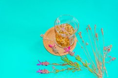 Cup of herbal tea with chamomile flowers. Product Image 1