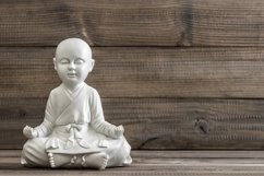 Sitting buddha. Relaxing concept Product Image 1