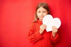 Lovely little girl holding large paper heart Product Image 1