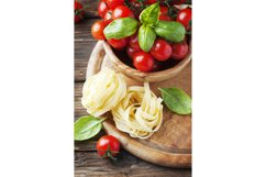 Concept of italian food with pasta, basil and tomato Product Image 1