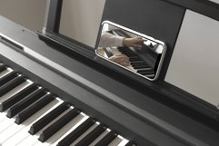 Isolated smartphone screen on piano Product Image 3