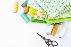 Sewing set with fabric, spools of thread, scissors and glass Product Image 1