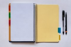 Spiral subject notebook, black pencil and pen. Flat view. Product Image 1