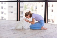 Cute teenage girl training her spitz dog at home Product Image 4
