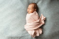 Cute newborn baby lies swaddled in pink blanket. Copy space Product Image 1