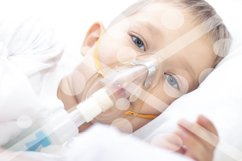 boy with an inhaler mask - respiratory problems in asthma. a Product Image 1