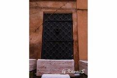 Vintage black metal door Antique building exterior detail Product Image 1