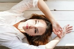 beautiful female model with her hands over head. Product Image 1