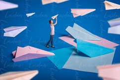 Surreal design. Young girl let paper airplanes. Product Image 1