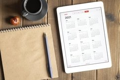 tablet with calendar for 2021, coffee, notebook, copy space Product Image 1