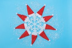 Christmas hats and snowflake on pastel blue background. Product Image 1
