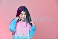 Girl listening to music on headphones on a pink background Product Image 4