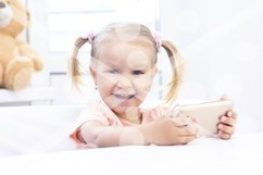 Girl using a mobile phone, a smartphone for video calls, tal Product Image 1