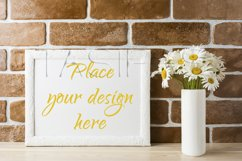 White landscape frame mockup with daisy bouquet in styled vase  Product Image 1